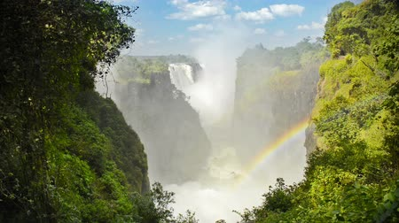 zambia : Victoria Falls Devils Cataract or Mosi-oa-Tunya waterfall in southern Africa on the Zambezi River at the border of Zambia and Zimbabwe in high definition footage with ambient audio. Victoria Falls is one of the 7 Wonders of the Natural World.