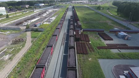 benzin : Aerial view UHD 4K of freight train with wagons and standing train with coal