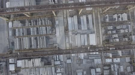 Take-off of the drone from warehouse with metal structures. Climb into air. Flight over factory. Take off from manufactory Dostupné videozáznamy