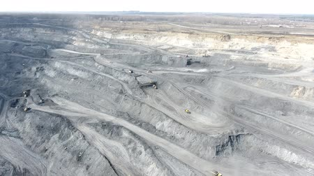 Panorama aerial view shot, open pit mine, coal mining, dumpers, quarrying extractive industry, stripping work