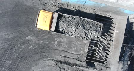 The dump truck unloads the coal in coal absorption. Dumper unload, the quarry, high-quality anthracite.