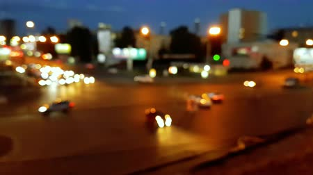 Concept cityscape blurred landscape, background style. Night view of modern city crowded street with illuminated skyscrapers, car traffic defocus.