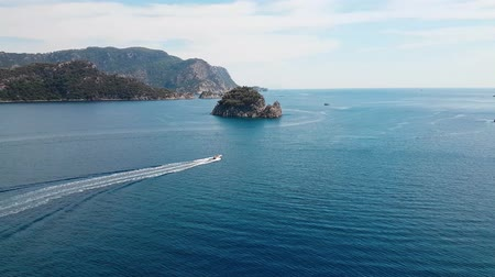 Panorama from shore to ocean from above. Aerial view of boat. Amazing beach with turquoise and transparent sea. Emerald Coast, Marmaris, Turkey