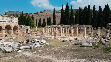 The ruins of old city debris of Turkish amphitheater. Archaeological Attraction. Ancient city Hierapolis near Marmaris in Turkey