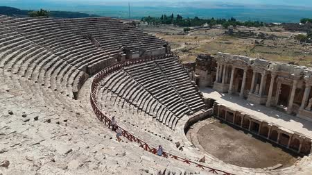 arkeolojik : The ruins of old city debris of Turkish amphitheater. Archaeological Attraction. Ancient city Hierapolis near Marmaris in Turkey