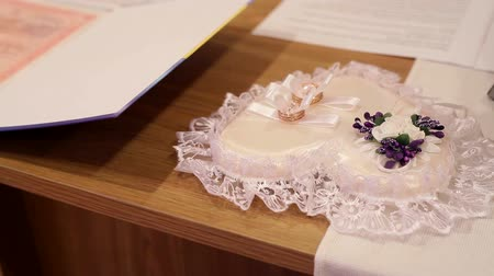 lacy : White cushion with wedding rings Stock Footage