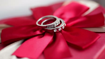 lacy : Wedding rings on a red bow