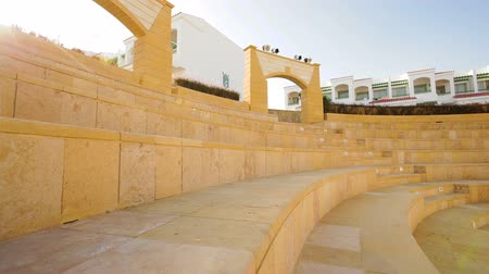 tiered : stone amphitheater for performances on territory of hotel Stock Footage