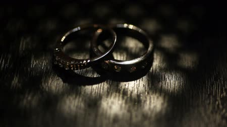 stylization : Two wedding gold rings and stars silhouettes