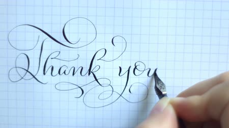 sayesinde : Text thank you with a pen on a sheet of paper. Calligraphy lettering