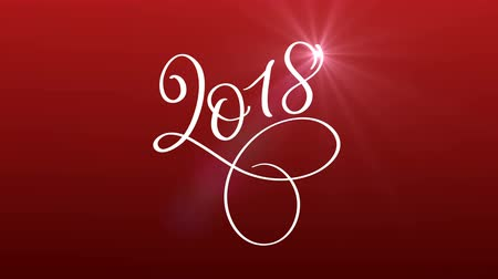bílý : 2018 happy new year calligraphy lettering text with glitter on red background. Christmas greeting animation for web banner or video holidays card