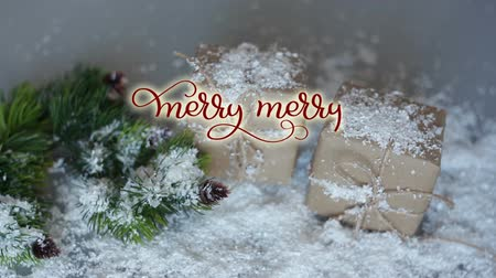 prapor : Written Merry merry Christmas vintage Calligraphy text on Christmas decor background with gifts. lettering flourish elements. Christmas holidays feeling Dostupné videozáznamy