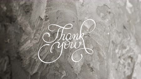 filigrana : Written animation Thank you calligraphy lettering text with Ornate frame elements on gray dirty grunge background. Vintage and filigree decoration. Filigree divider animation words