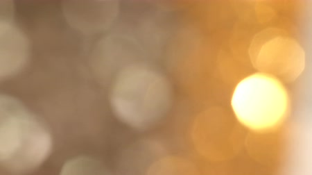 блестящий : Abstract Gold bokeh lights in motion in 4k video. High quality render of gold particles. Ideal for Christmas, valentines day, wedding, love, celebration and party videos as background Стоковые видеозаписи