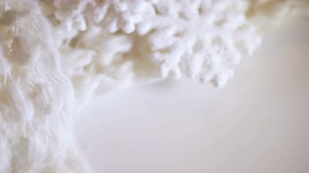 slider shot : Macro dolly shot of soft warm white woolen fabric to keep warm in winter. Christmas clothes or blanket closeup Stock Footage