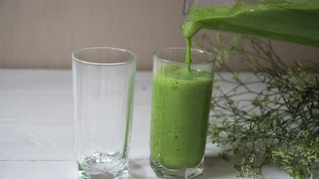 сельдерей : Blended green smoothie with ingredients or cocktail on white background, breakfast vegan with a place for your text, concept of raw food detox