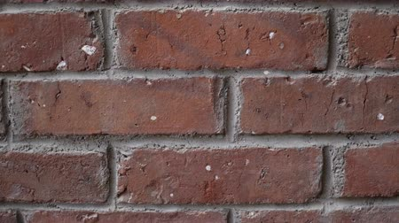 taş işçiliği : Orange grunge old bricks headers and stretchers close-up slow-tilt 4K UltraHD footage - house wall texture details shallow 3840X2160 UHD tilting video Stok Video