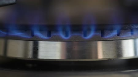 firebox : Natural gas inflammation in stove burner, close up view Stock Footage