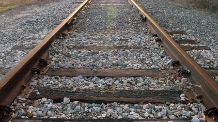 lokomotif : Low angle of railroad tracks (centered), 4K