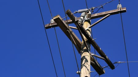 sintonia : Electric power line against clear blue sky, 4K Stock Footage