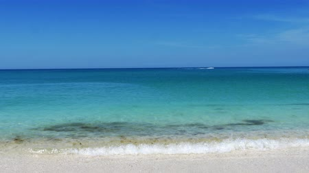 cobalt : Beautiful blue water at the beach gentle waves jet ski in distance 4K Stock Footage