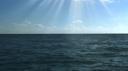 eixo : Sunshine over calm blue sea, 4K Stock Footage