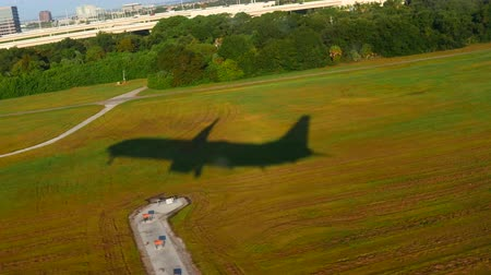 tampa bay : Aerial Plane shadow taking off from Florida Airport Stock Footage