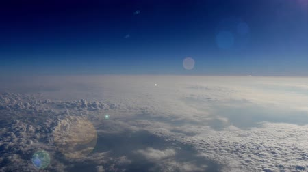 moře : Aerial of Earths atmosphere with Lens Flare, 4K