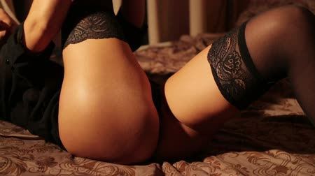 eşek : Beautiful girl in lingerie lying on the bed HD Stok Video