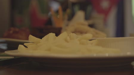 маслянистый : French fries on a plate at the bar. Fast food