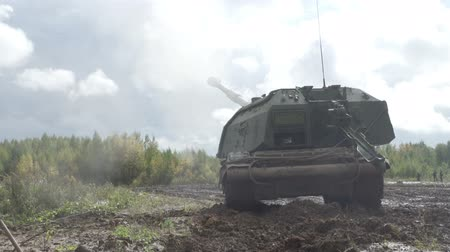 bundeswehr : Self-propelled artillery unit fires a shell. Shot out of a cannon
