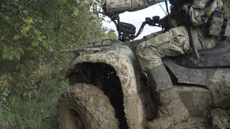 quads : Military ATV with a gun in the mud