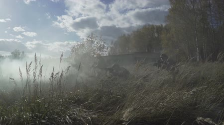 подразделение : Military smoke go through the battle. Soldiers are attacking through smoke ambush