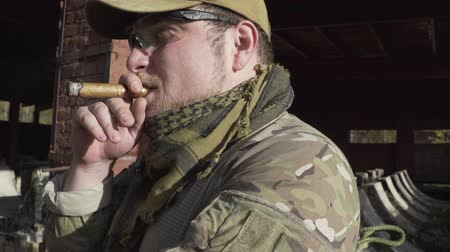 spec ops : Military smoking a cigar near a building Stock Footage