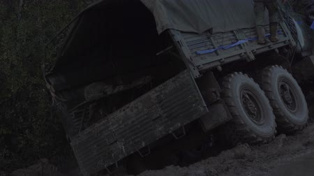 hnědožlutý : Military truck stands in the mud. Dirty trucks.