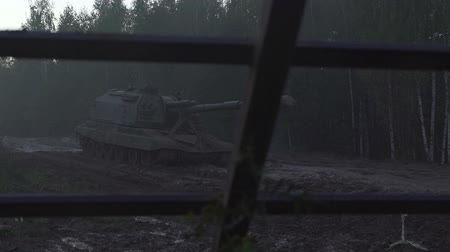 armoured : Self-propelled artillery unit on the road in a forest Stock Footage