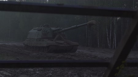 propelled : Self-propelled artillery unit on the road in a forest Stock Footage