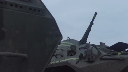 armoured : gun on an armored personnel carrier. Machine gun on a military vehicle.