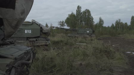 стенд : Self-propelled artillery unit in the stands. Military armored vehicles.