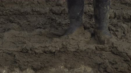 boggy : The military are on a dirt road. Dirt-Caked Boots and legs. Stock Footage