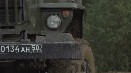 caqui : Army Staff Russian truck driving on dirt road. Dirty armored vehicle. Stock Footage