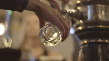 beer tap : woman pours beer into a glass
