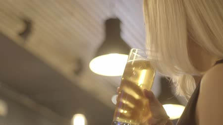 Октоберфест : blonde girl drinking beer from the glass