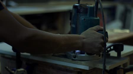 earmuffs : furniture factory production and processing of sawing the wood element Stock Footage