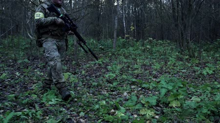 stealth : soldier with a sniper rifle in the forest are