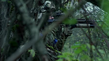 commando : military in the forest perform a task