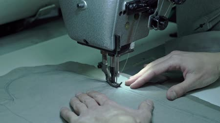 spool : Taylor sews part of the sewing machine Stock Footage