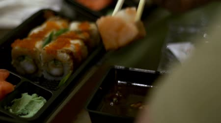 kaviár : People eat sushi and rolls Japanese chopsticks