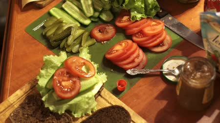 pita : cucumber, tomatoes, lettuce cut for cooking and salad sandwiches Stock Footage