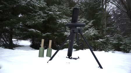 wwii : Mortar is charged and ready to fire in the winter forest